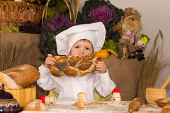 Little boy in the cook costume Stock Images