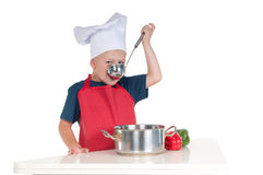 Little boy cooking Stock Photo