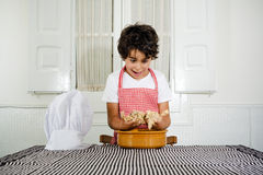 Little boy cooking Stock Photos