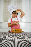 Little boy cooking Stock Photography