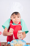 Little boy cooking cake home made bakery Stock Images