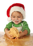 Little boy cooking the Christmas cake Stock Image