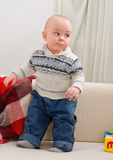 Little boy costs on a sofa Royalty Free Stock Photo