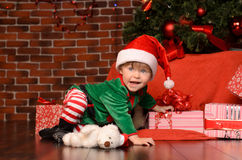 Little boy in costume in christmas interior Stock Photos