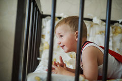 Little boy in the cot Royalty Free Stock Images