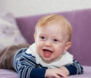 Little boy  on   couch. Stock Image