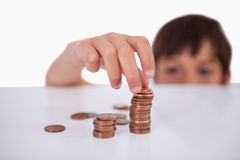 Little boy counting his change Stock Photo