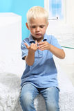 Little boy counting on his fingers Stock Image
