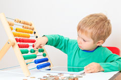 Little boy counting his savings Royalty Free Stock Image