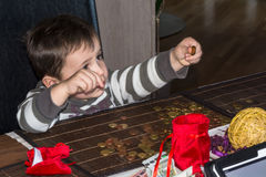 Little boy counting money. Child and a pile of money coins. Concept Save money Royalty Free Stock Image