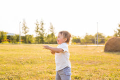 Little boy in the countryside. Toddler playing active games outdoors. Childhood, carefree, children's games, boy, fresh Royalty Free Stock Photography