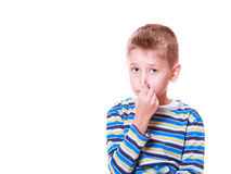 Little boy cover nose with fingers. Royalty Free Stock Image
