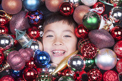 Little boy covered in ornaments. Royalty Free Stock Image