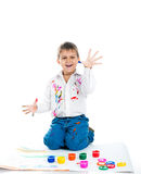 Little boy covered in  paint Stock Photos