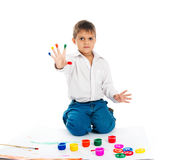 Little boy covered in a paint Stock Photos