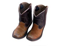 Little boy cowboy boots. Used and scuffed leather child cowboy boots isolated on white background royalty free stock photos