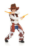 Little boy cowboy. Full length of funny furious little boy in a suit of the cowboy holding guns, on a white background Stock Photo