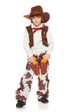Little boy cowboy. Full length of little boy in a suit of the cowboy posing with guns, on a white background Royalty Free Stock Images