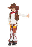 Little boy cowboy. Full length of little boy in a suit of the cowboy showing thumb up sign, on a white background Royalty Free Stock Photography