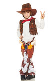 Little boy cowboy. Full length of little boy in a suit of the cowboy showing victory sign, on a white background Royalty Free Stock Images