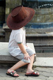 Little Boy With Cowboy Hat, Asian Kid. Asian little young boy at Victoria Fountain Melaka with cowboy hat Royalty Free Stock Photo