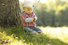 Little boy in a cowboy hat playing on nature Royalty Free Stock Photography