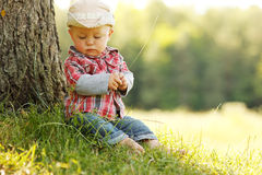 Little boy in a cowboy hat playing on nature Stock Photography
