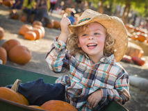 Little Boy in Cowboy Hat at Pumpkin Patch Royalty Free Stock Photos