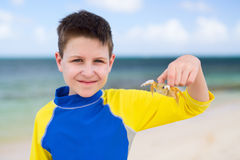 Little boy with a crab Royalty Free Stock Photography