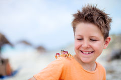 Little boy with a crab Stock Images