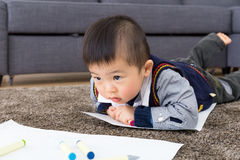 Little boy crawling for drawing Royalty Free Stock Photo