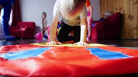 A little boy crawling in front of the camera. Around the toys. Animators entertain children. A children`s party. Close up stock video
