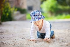 Little boy crawling on stone paved sidewalk Royalty Free Stock Photo
