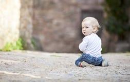 Little boy crawling on stone paved sidewalk Stock Image