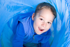 Little boy at the crawling tunnel Royalty Free Stock Image