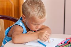 Little boy crayons Stock Photo