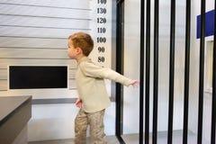 Boy criminal escapes from prison, police station on playground. Little boy criminal escapes from prison, police station on playground stock photography