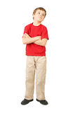 Little boy crossed hands standing on white Royalty Free Stock Image