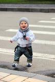 Little boy crossing a street Royalty Free Stock Image