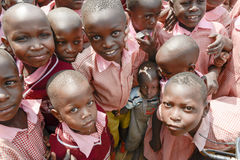 Little boy crowded between students, Uganda Stock Photos