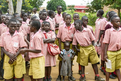 Little boy crowded between students, Uganda Royalty Free Stock Image