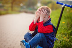 Little boy crying, fell from the scooter in open air Royalty Free Stock Photos