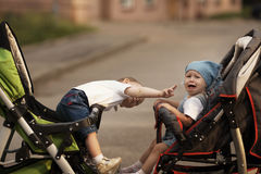 Little boy and crying girl stock photos