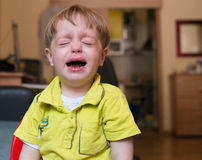 Little boy crying at home Stock Photos