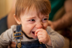 Little boy crying next to his dad Stock Photo