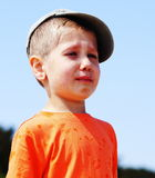 Little boy crying outdoor Stock Images