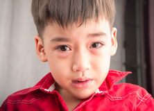 Little boy crying with sadness Stock Image