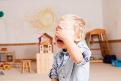 Little boy is crying. Because somebody stole his toy Royalty Free Stock Image