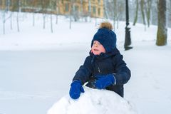 Little boy is crying in the winter in the cold. the child is sad stock photos