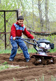 Little boy with cultivator Royalty Free Stock Images